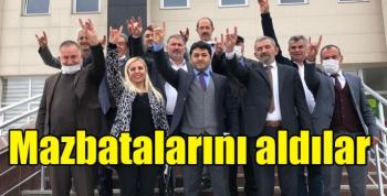 MHP Kars İl Başkanı ve yönetimi mazbatalarını aldı